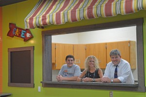 B-A high school student Kermit Foor; B-A director of instruction, technology and media Jamie Forshey; and Superintendent Dr. Tom McInroy pose at the ordering window to the middle/high school's new media center café which will be open to students and staff this school year.