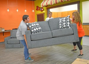 B-A student Kermit Foor and B-A Foundation President Crystal Himes earlier this week move a loveseat into the new media center at the B-A middle/high school library.